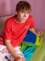 Happy twink stroking his swelling dick through the shorts fabric