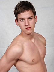 Sweet blue-eyed twink demonstrates his naked body