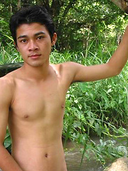 Sexy Thai guy strips in the wild