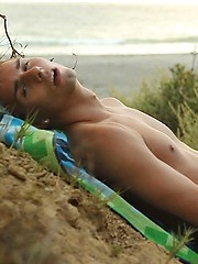 Jacobey London jerks off on a nude beach while checking out other hot naked guys