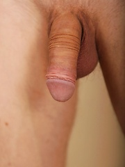 Gorgeous Tommy Jax stroking his firm uncut cock.