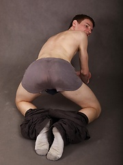 Luke Dole spreads his ass while stroking his hard cock.